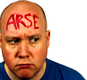 "Guy Wah with ""arse"" written on his forehead"