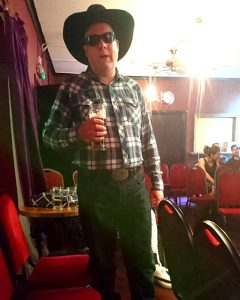 Me dressed as a cowboy, holding a beer
