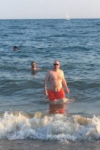 Guy looking sexy and buff getting out of the sea